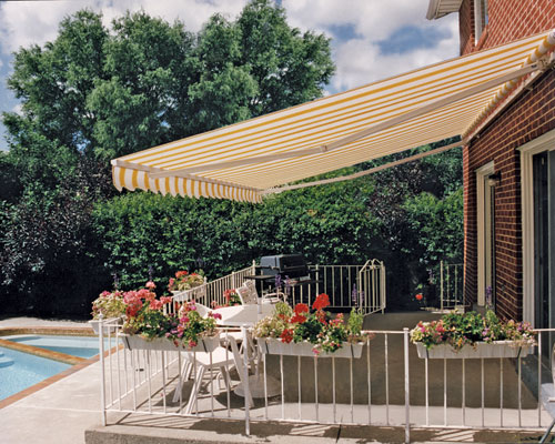 residential striped sunbrella fabric retractable awning brick wall mounted