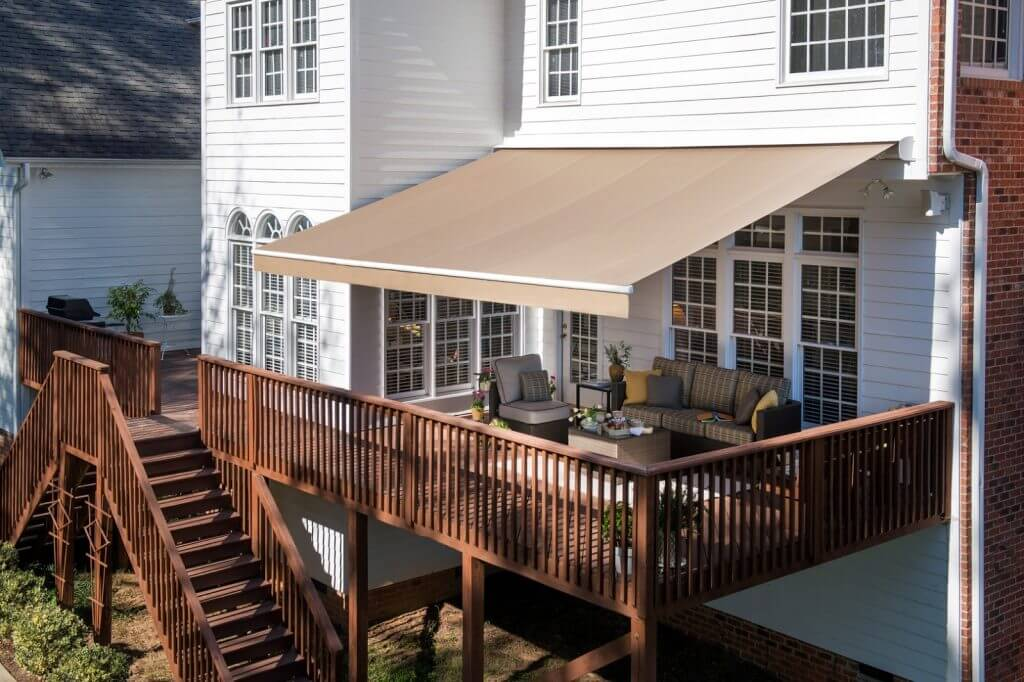 residential sunbrella solid fabric retractable awning with straight valance