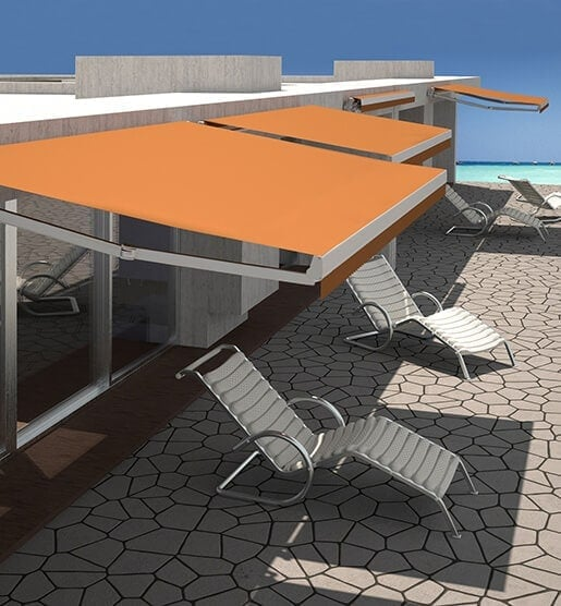 Retractable deck long projection folding lateral arm awnings